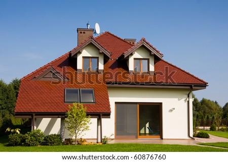 Single family white house over blue sky - stock photo