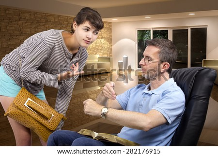 Single father waiting for daughter to come home late at night past curfew.  The dad is sitting on a chair.  This image depicts fatherhood or being a single parent. - stock photo