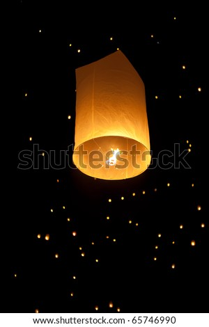 Single Floating Lantern during Firework Festival in Thailand - stock photo