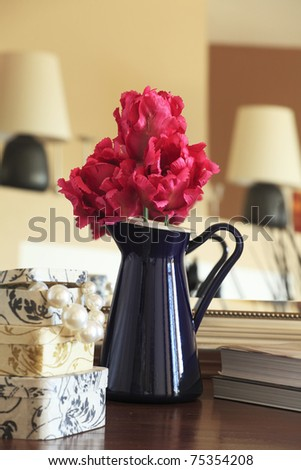 Single flower arrangement in an iron pitcher with pearls - stock photo