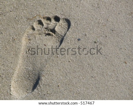 single footprint in the sand - stock photo