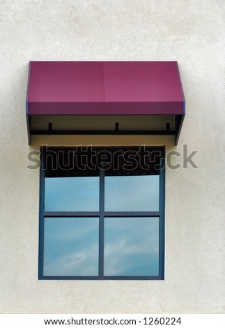 Single four paned window with a maroon awning