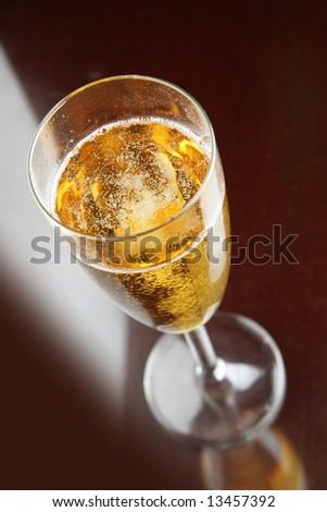 Single glass of champagne close-up over black background - stock photo