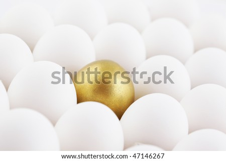 single golden egg in row