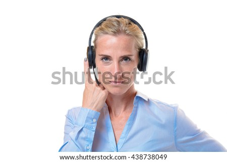 Single gorgeous short haired blond woman with telephone headset on head and finger holding side over white background - stock photo