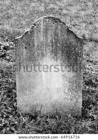 single grave stone standing in a church grave yard - stock photo