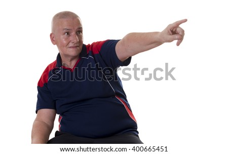 Single grinning balding man in blue and red short sleeve shirt pointing finger at something over white background - stock photo