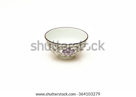 Single hand painted oriental soup bowl on white background with reflection. A bowl is a round, open-top container used in many cultures to serve hot and cold food. - stock photo