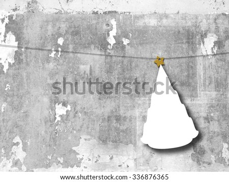 Single hanged Christmas tree shaped frame with star on grey concrete wall background