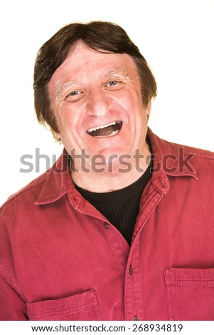 Single happy mature man in red shirt laughing