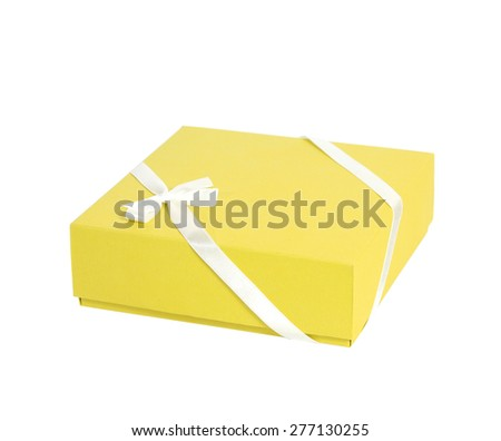 Single horizontal yellow box with white ribbon on white background, cut out - stock photo