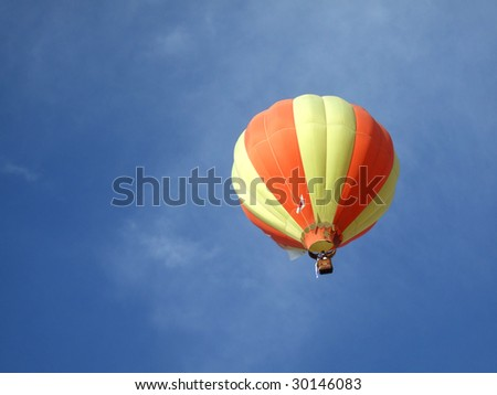Single hot air balloon with blue sky - stock photo