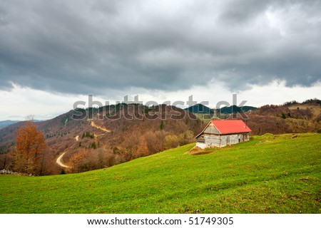 Single house on a meadow in mountains