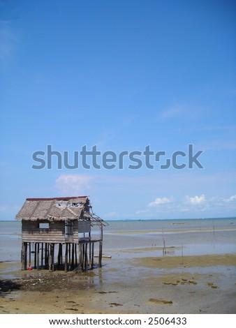 Single hut by beach at Bintan Indonesia - stock photo