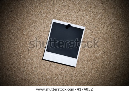 single  instant photo hanging on a message board - stock photo
