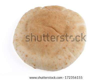 Single israeli flat bread pita isolated on white background - stock photo