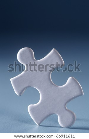 Single jigsaw piece isolated on the blue background.