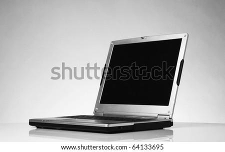 single laptop pc computer shot on white background - stock photo