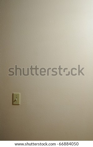 Single light switch with wall copyspace - stock photo