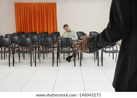Single male executive listening to a seminar in conference room - stock photo