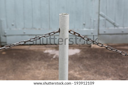 single metal stanchion with chain - stock photo