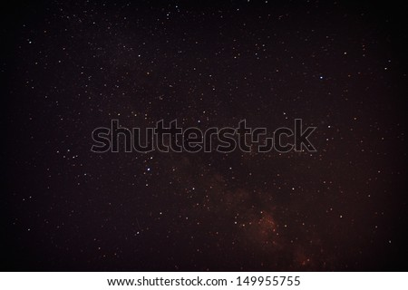 Single meteor from the Perseid meteor shower with the Milky way in the background. High ISO image. - stock photo