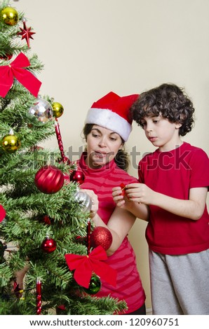 Single mother and son putting together a Christmas Tree - stock photo