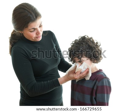 Single mother helping her son to blow his nose. White background - stock photo