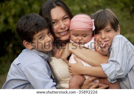 Single Mother with her three child, two sons and baby girl - stock photo