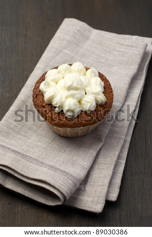 Single muffin on a towel - stock photo