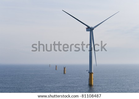 Single Offshore Wind Turbine in a Windfarm under construction  off the English Coast, North Sea - stock photo