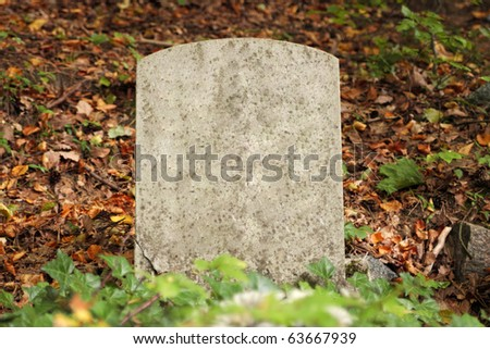 Single old grave in autumn - stock photo