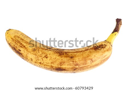 Single old yellow banana. Closeup. Isolated on white background. Studio photography.