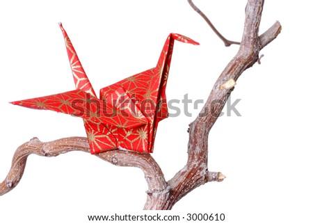 Single Origami Peace Bird on a Bare Branch - stock photo