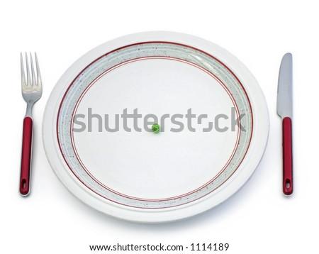 Single pea on plate - stock photo