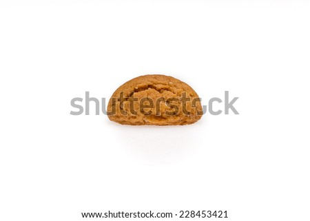 Single pepernoot, a typical dutch treat for Sinterklaas on 5 december. Cookie isolated on white background, front view. - stock photo
