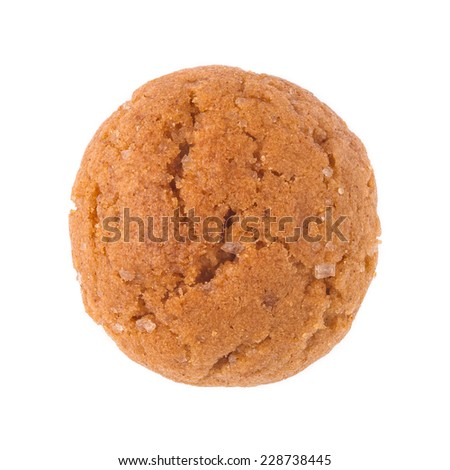 Single pepernoot close up. A traditional dutch treat for Sinterklaas on 5 december. Detailed cookie isolated on white background. - stock photo
