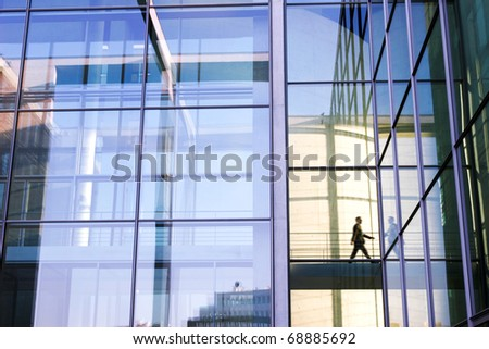 Single Person behind big office front - stock photo