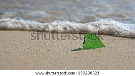 Single Piece of Green Sea Glass on the Shoreline - stock photo