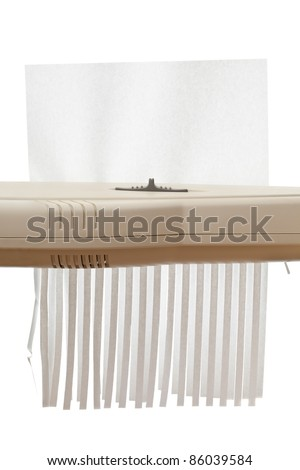 Single piece of paper with copy space in shredder - stock photo
