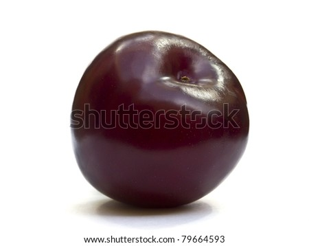 Single plum isolated on a white background - stock photo