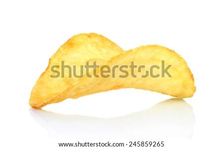 Single potato chip on white background close-up  - stock photo
