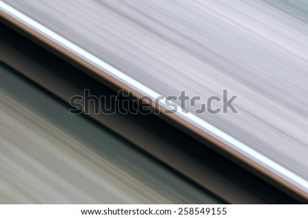 Single rail in motion speed concept railway transportation diagonal - stock photo