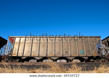 Single railroad car on track as part of a freight train on a bright winter day in Colorado. - stock photo