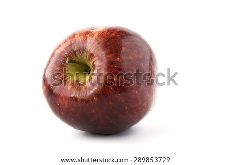Single red apple isolated on white close up