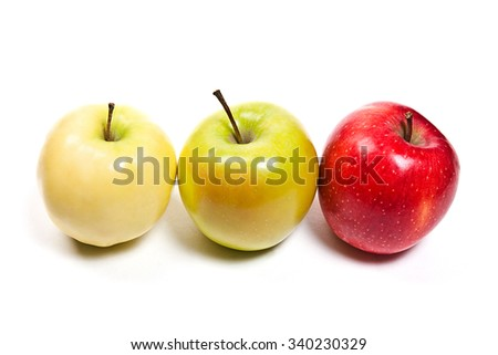 Single red apple, one green and one yellow apple. Three juicy ripe fruits. Isolated on white background. - stock photo