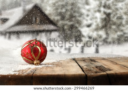 single red ball on wooden board snow decoration and space for you  - stock photo