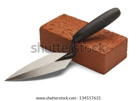 Single red brick with trowel isolated on white background. - stock photo