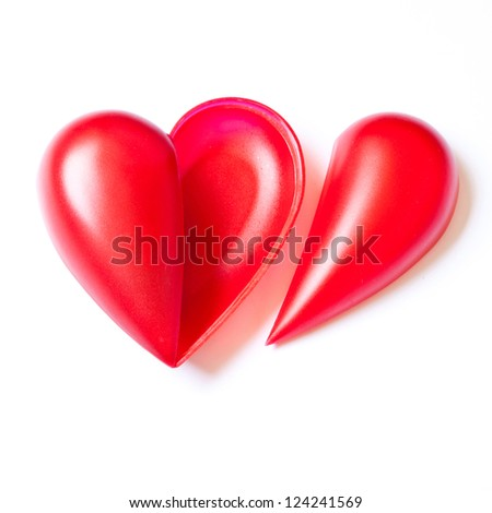Single red hearts on white background