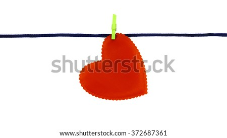 Single red love shape clipped on blue rope isolated on white background - stock photo